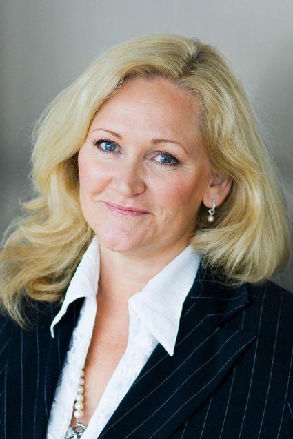 Kommunikasjonsdirektør Guri Wormdahl avviser at Opplysningen har satt kjøpet av Aspiro søk i samband med nedleggelsen av avdelingen på Sortland.