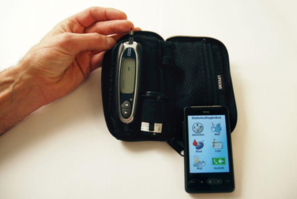 Måler blodsukkeret med mobilen