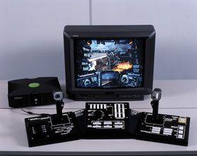 Forgjengerens gigantiske og obligatoriske spillkontroller.