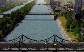 Byen deles av elv.