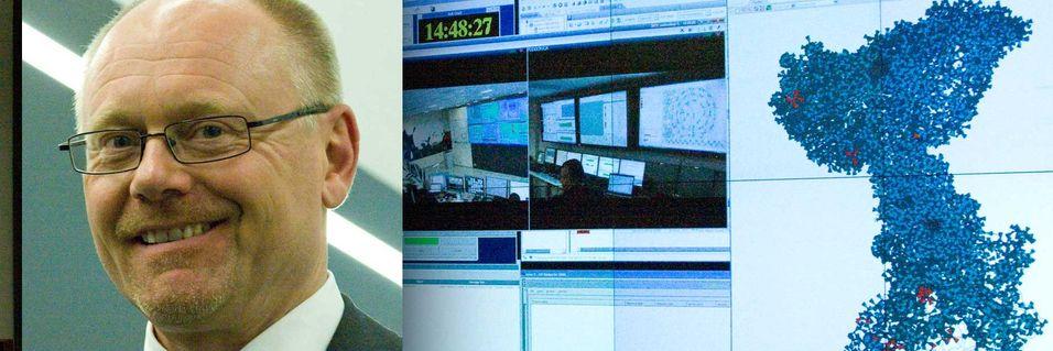 Lederen for Telenor Common Operations, Øystein Mikkelsen i driftssenteret. Kartet til høyre viser status for basestasjoner i Ungarn, Serbia og Montenegro.