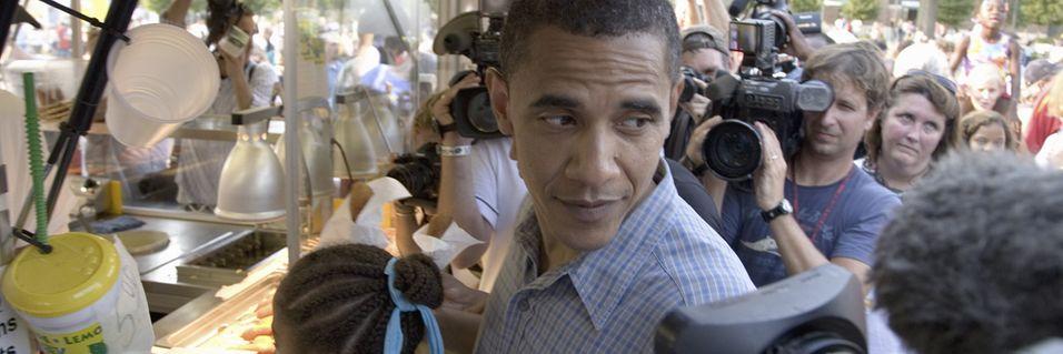 Nektes å fotografere Obama