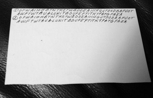 """Dette er baksiden av brevet. De to øverste linjene er """"Fader Vår"""" på engelsk."""