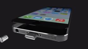 Delene nederst i konseptmodellen settes inn i mobilen.
