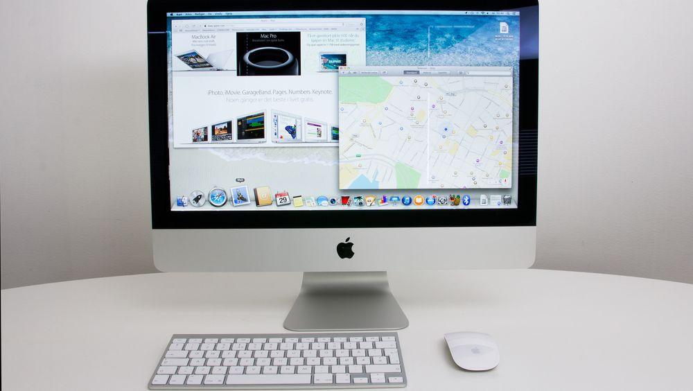 iMac med medfølgende tastatur og Magic Mouse.