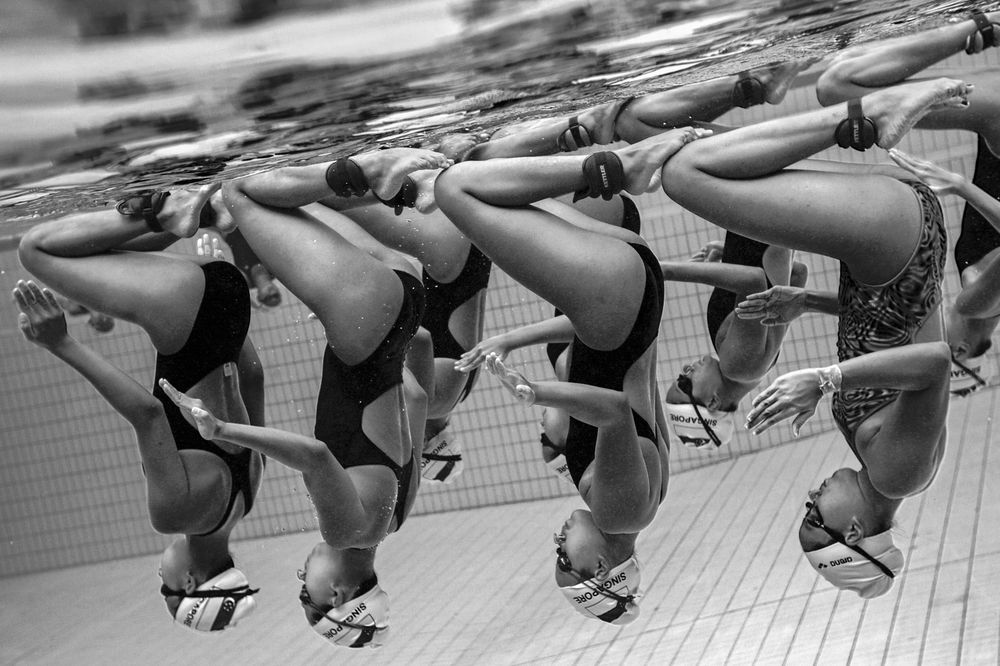 he photographer attempts to capture the underwater grace and juxtaposition of the synchronized swimming team trainings in Singapore.