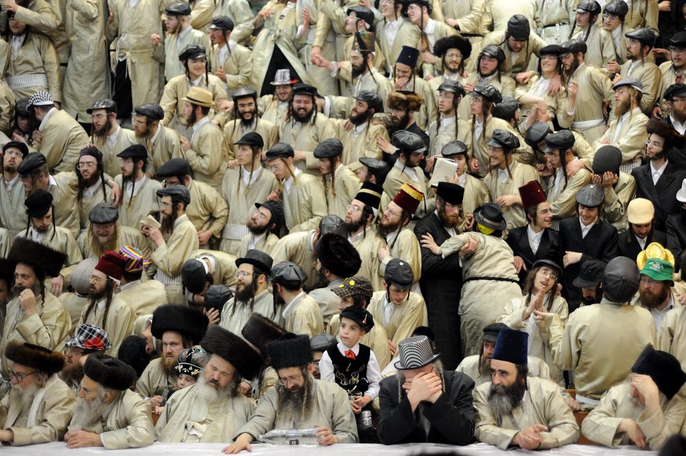 Ultra-Orthodox Jewish men of the Toldot Aharon Sect celebrate the Purim holiday in the ultra-orthodox Mea Shearim neighborhood in Jerusalem on March 17, 2014. The festival of Purim commemorates the rescue of Jews from a genocide in ancient Persia.