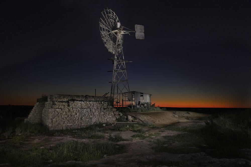 Light painting of a disused windmill on an abandoned farm situated on the edge of the Nullarbor desert.