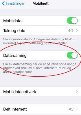 Skru av Dataroaming på en iPhone ved flikke bryteren så den blir hvit.