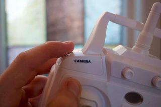 Ved hjelp av denne knappen starter du kameraet på Focus Drone.