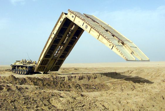 030206-M-5753Q-011Camp Coyote, Kuwait (Feb. 6, 2003) -- An M60A1 Armored Vehicle Landing Bridge (AVLB) practices the deployment of its 60 foot bridge span, designed to quickly move heavy military wheeled and tracked vehicles over unstable or hazardous terrain.  The equipment is being used in exercises being conducted as part of Operation Enduring Freedom.  U.S. Marine Corps photo by Lance Cpl. Kevin Quihuis Jr.  (RELEASED)