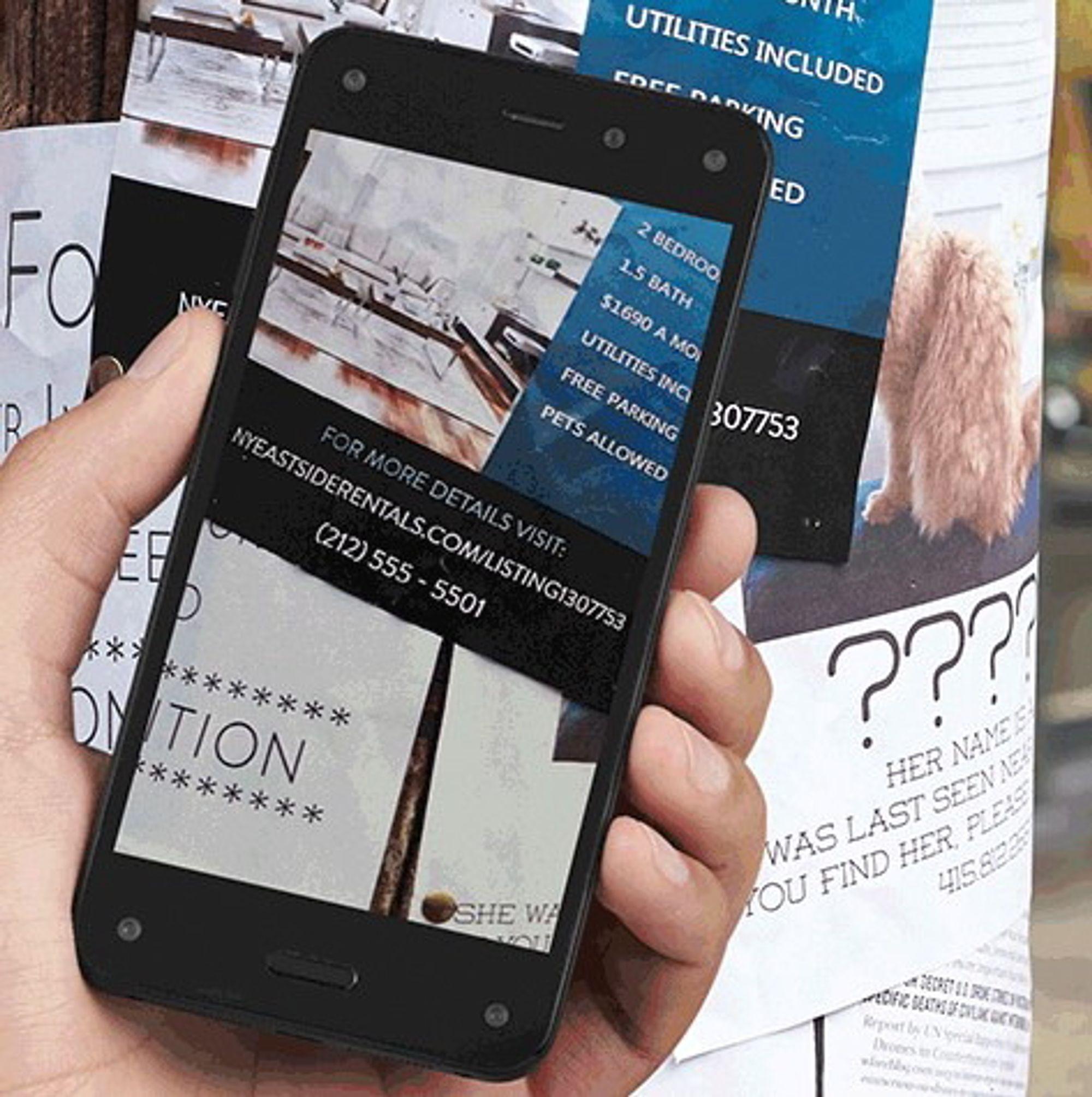 """Ved hjelp av en egen knapp skal mobilen være i stand til å gjenkjenne over 100 millioner """"ting"""", inkludert musikk, bøker, filmer, med mer. Formålet er å geleide brukeren til å kjøpe varer og tjenester gjennom Amazon-universet."""