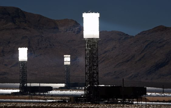 PRIMM, NV - JULY 23: The three towers at the Ivanpah Solar Electric Generating System are shown in operation on July 23, 2014 in the Mojave Desert in California near Primm, Nevada. The largest solar thermal power-tower system in the world, owned by NRG Energy, Google and BrightSource Energy, opened earlier this year in the Ivanpah Dry Lake and uses 347,000 computer-controlled mirrors to focus sunlight onto boilers on top of three 459-foot towers, where water is heated to produce steam to power turbines providing power to more than 140,000 California homes.   Ethan Miller/Getty Images/AFP== FOR NEWSPAPERS, INTERNET, TELCOS & TELEVISION USE ONLY ==