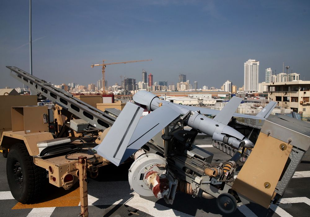 "A ScanEagle drone sits on the deck of the USS Ponce in Manama, Bahrain, Friday, Dec. 6, 2013. Standing on the massive deck of the Navy's USS Ponce, Hagel said the U.S. is entering the new nuclear pact with Iran ""very clear eyed"" and it remains to be see whether Tehran is serious about keeping its development peaceful. (AP Photo/Mark Wilson, Pool)"