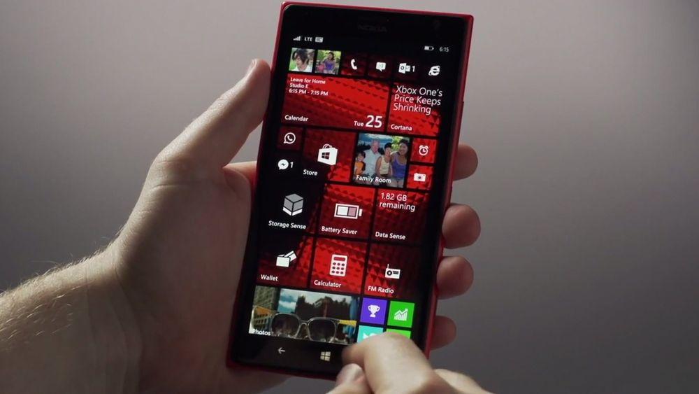 Windows Phone 8.1 har mulighet for personlige bakgrunner på flisene.