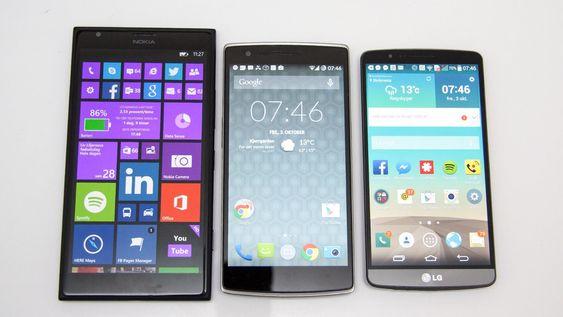 Oneplus One (i midten), med LG G3 til høyre og Nokia Lumia 1530 til venstre.