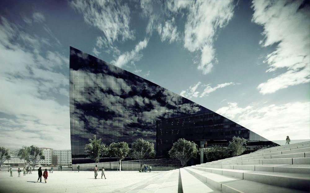 Dette forretningsbygget på Brattørkaia i Trondheim skal Powerhousalliansen snart begynne å bygge. Det skrå taket er valgt for å gi solcellene optimal vinkel mot solen.