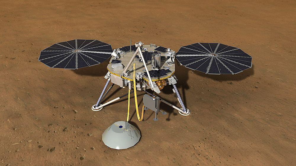 I ARBEID: Slik ser Nasa for seg Insight i arbeid. I dette tilfellet i ferd med å utplassere et instrument for å måle temperatur og  seismisk aktivitet.