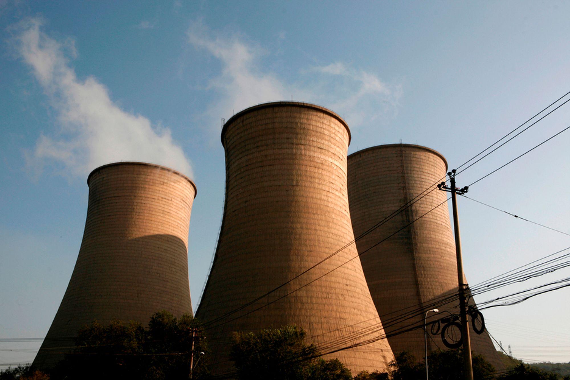 Kina forbereder seg på hva som kan skje dersom det ikke er blitt enighet om en ny klimaavtale når Kyoto-avtalen utløper i 2012. Bildet viser et kraftverk utenfor den kinesiske hovedstaden Beijing