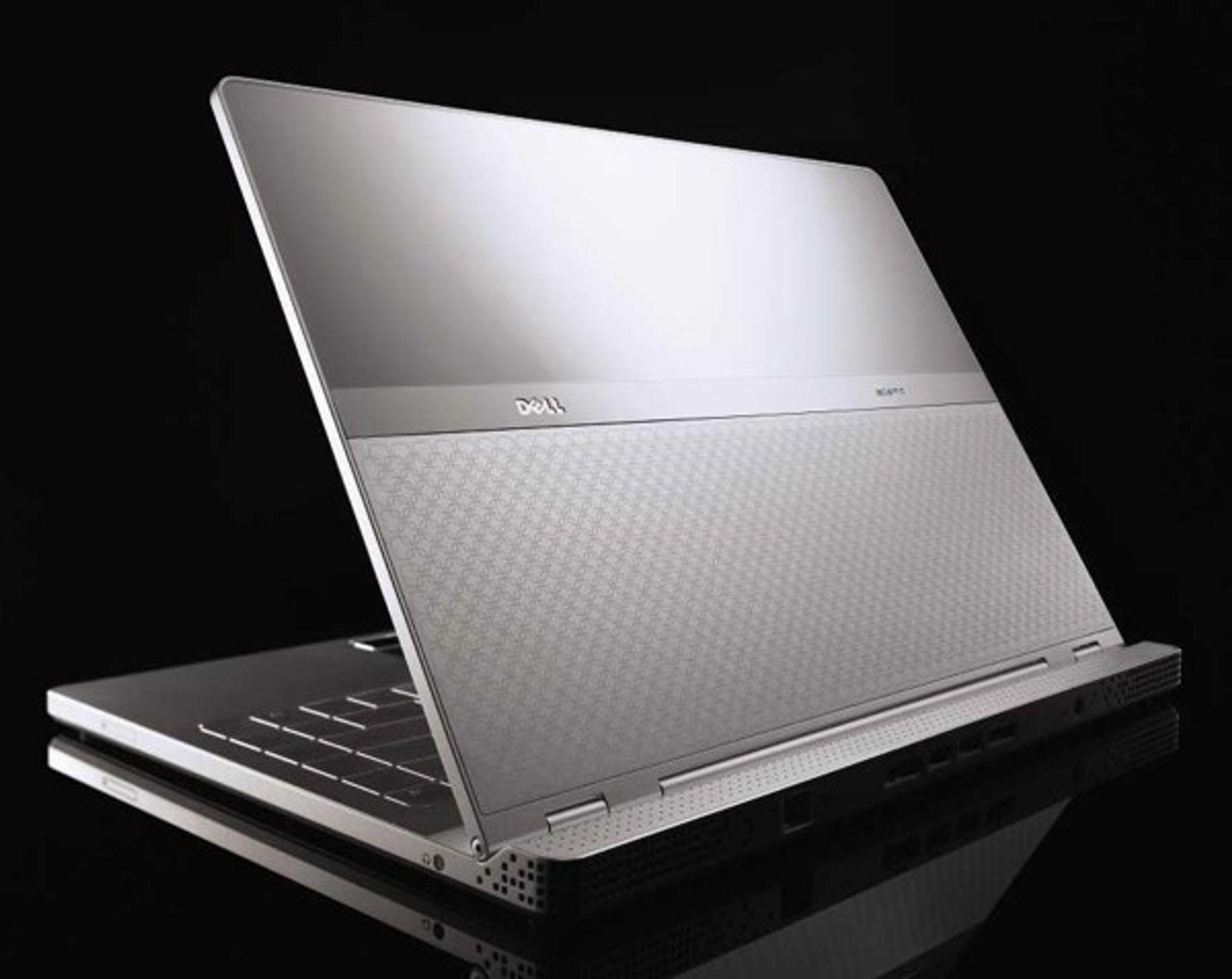 Dells Adamo er tynnere enn Macbook Air, men veier litt mer. Den koster imidlertid flesk.