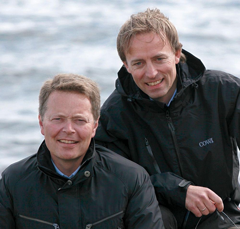 LYS FREMTID: Cowi-direktørene Christian Nørgaard Madsen, til venstre, og Terje Bygland Nikolaisen økte både omsetning, resultat og ordrereserve i første halvvår.
