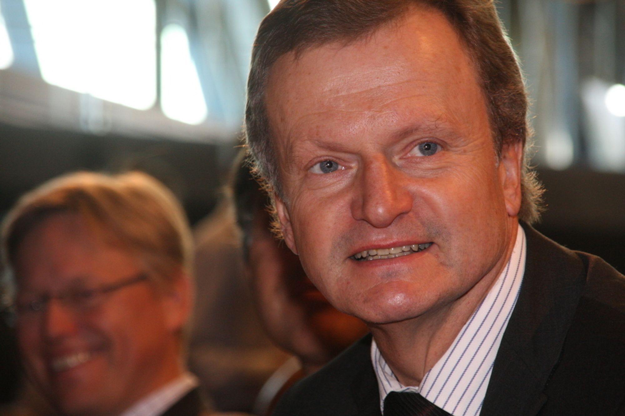 KAN SMILE: Telenors konsernsjef Jon Fredrik Baksaas inngår sammenslåingsavtale med russiske Altimo. Dermed forsvinner de pågående rettsprosessene.