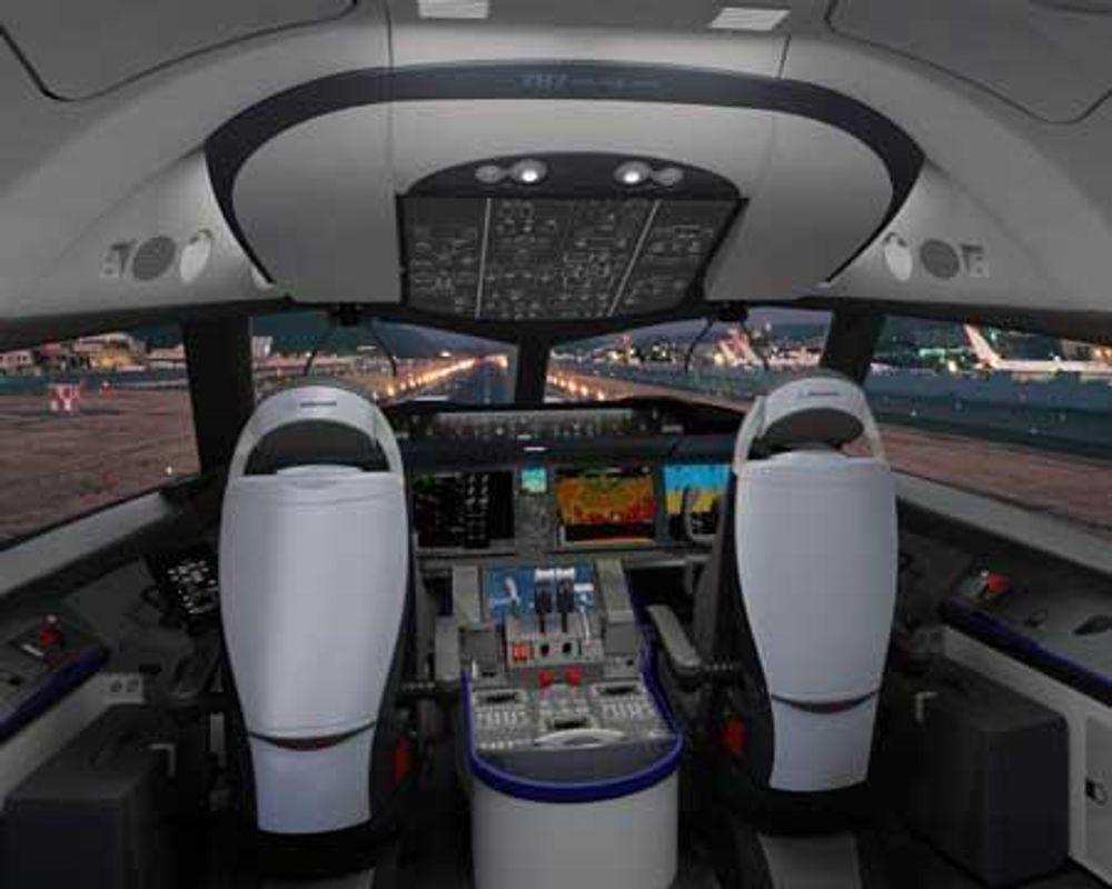 DRØMMECOCKPIT: Cockpit i Boeings nye passasjerfly Dreamliner ble vist 31.8. 2005. Dataskjermene er ekstra store og ekstra lyssterke når det er sol ute. De klarere å overføre enda mer informasjon, om pilotene så ønsker. Familielikheten med Boeings store 777 er laget så stor som mulig, slik at det blir lettere for et flyselskap å bruke samme piloter på begge flyene.