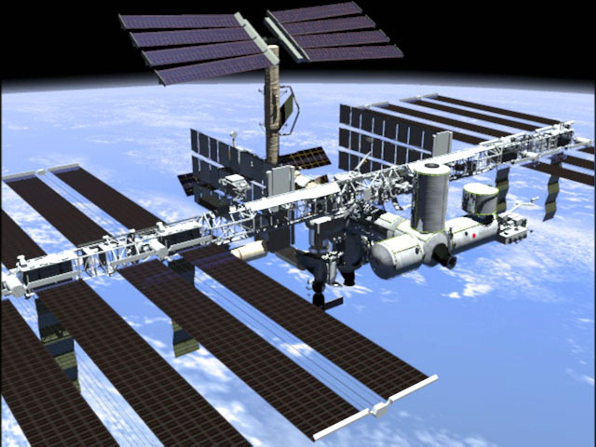 SVEVER OVER OSS: Den internasjonale romstasjonen ISS blir ikke like omfattende som opprinnelig planlagt.