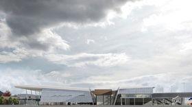 Her sees terminal 3 fra siden, og vingespenn-temaet med tak som skrår ned mot midten.