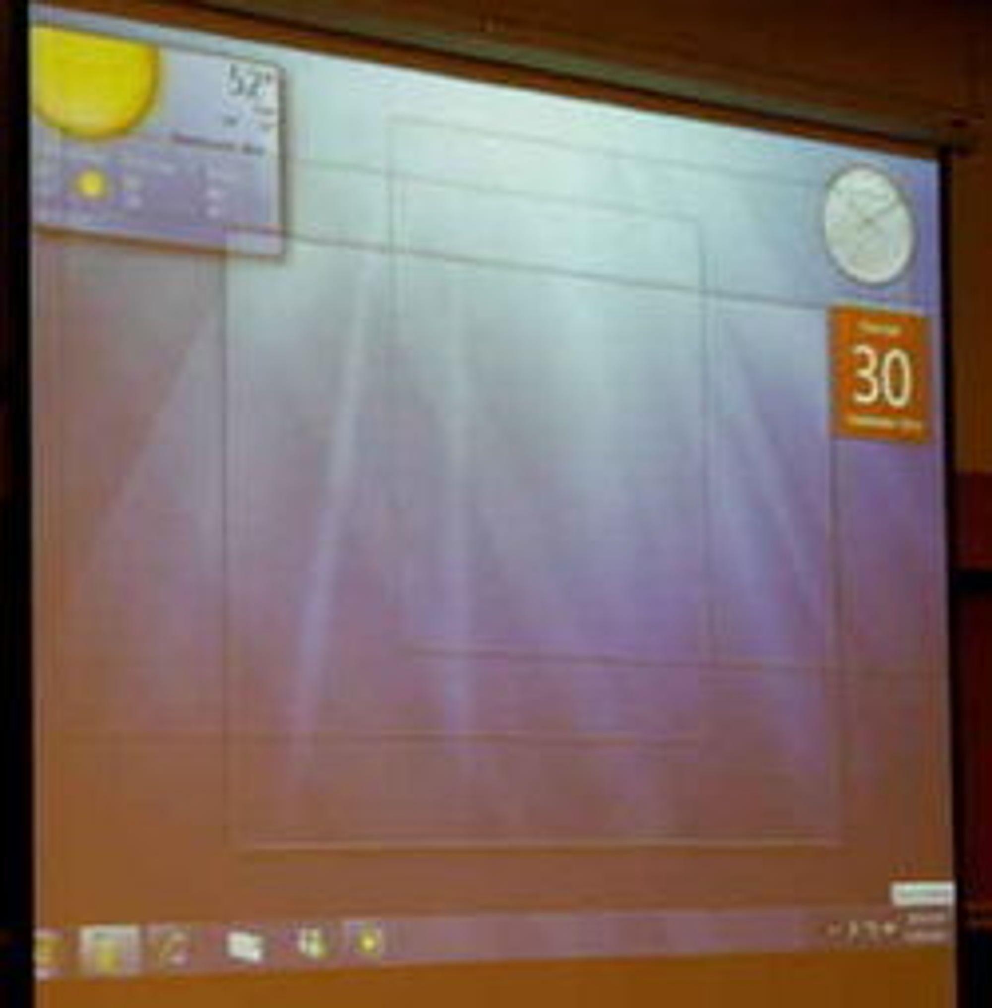 I Windows 7 blir vinduene gjennomsiktlige hvis man drar musen over et ikon nederst til høyre på skjermen.