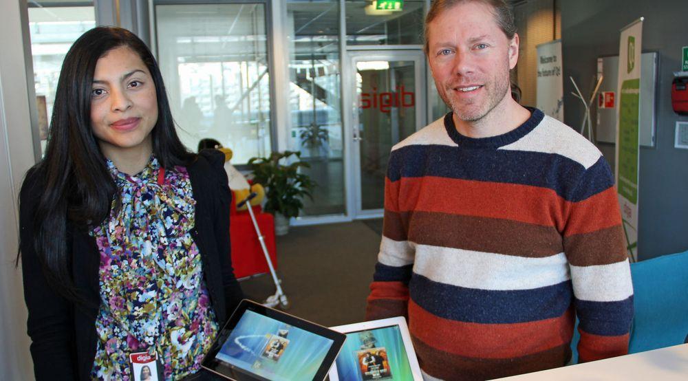 Katherine Barrios og Lars Knoll ved Digia i Oslo kunne vise fram Qt-baserte applikasjoner for både Android- og iOS-baserte nettbrett.