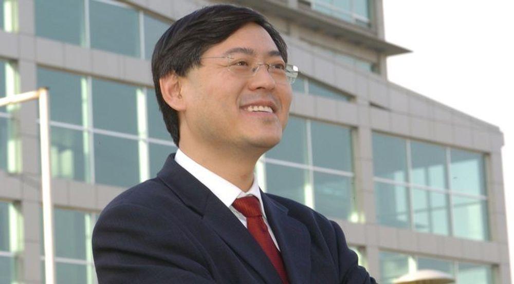 Lenovo-sjef Yang Yuanqing stråler av optimisme.