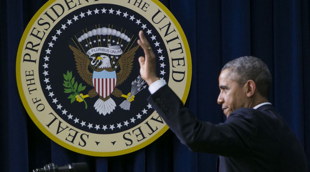United States President Barack Obama waves to the audience