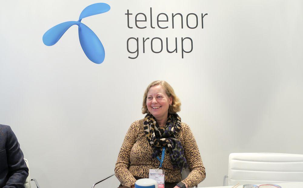 En god dag på jobben: Adm. direktør i Telenor Norge, Berit Svendsen, har mange nyheter til de norske mobilkundene fremover. Ikke minst for de som sliter med dekningen innendørs.