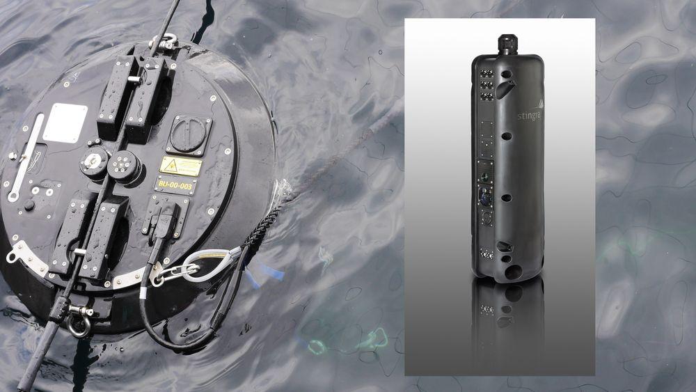 Bare toppen av bøyene skimtes på overflaten i merdene. Under henger noden som skyter lakselus automatisk med laser, helt ned til 30 meter. Foto: Stingray Marine Solutions