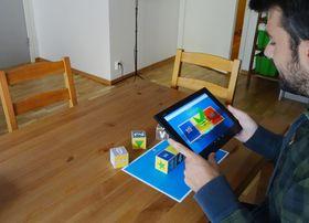 Spillet tar i bruk utvidet virkelighet med fysiske klosser.