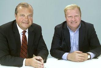 Evry med konsernsjef (fra v.) Björn Ivroth i spissen får fornyet tillit av administrerende direktør Jon Oluf Brodersen og Sparebank 1 Banksamarbeidet DA.