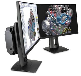 Maskinen kan monteres på baksiden av skjermen for å spare plass.
