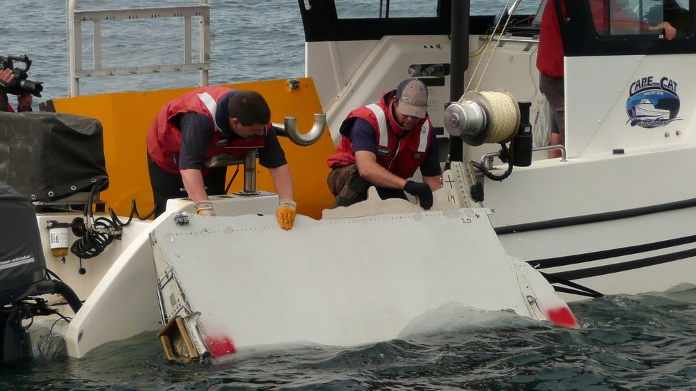 A Boeing 777 flaperon cut down to match the one from flight MH370 found on Reunion island off the coast of Africa in 2015, is lowered into water to discover its drift characteristics by Commonwealth Scientific and Industrial Research Organisation researchers in Tasmania, Australia, in this handout image taken March 23, 2017. CSIRO/Handout via REUTERS TPX IMAGES OF THE DAY FOR EDITORIAL USE ONLY. THIS IMAGE HAS BEEN SUPPLIED BY A THIRD PARTY. IT IS DISTRIBUTED, EXACTLY AS RECEIVED BY REUTERS, AS A SERVICE TO CLIENTS