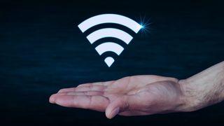 Utstrakt hånd med Wi-Fi-symbolet over.