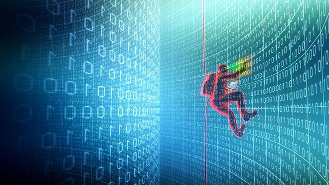 Hacker som klatrer på en vegg av nuller og ettall.
