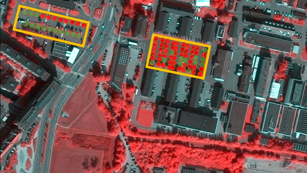 Ved hjelp av bilder som dette av parkeringsplasser, kan man automatisere beregninger av belegningsprosent på parkeringsplasser. På dette bildet er to parkeringsplasser i København markert med henholdsvis røde og grønne markeringer, avhengig av om den enkelte plassen er opptatt eller ikke.