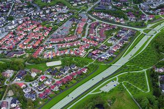 Fotomontasje som viser ny E39 nordover fra Eiganestunnelen til overgangen mot dagens veg. Til venstre i bildet ses omlagt Ytre Ringvei Vest fra Byhaugtunnelen til krysset med Randabergveien.