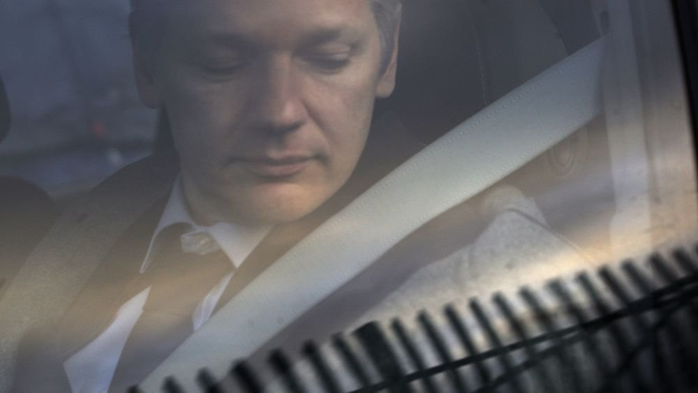 FILE - In this Jan. 11, 2011 file photo, WikiLeaks founder Julian Assange arrives at Belmarsh Magistrate's court in London for an extradition hearing. According to a cache of internal WikiLeaks files obtained by The Associated Press, Assange sought a Russian visa and staffers at his radical transparency group discussed having him skip bail and escape Britain as authorities closed in on him in late 2010. (AP Photo/Sang Tan)