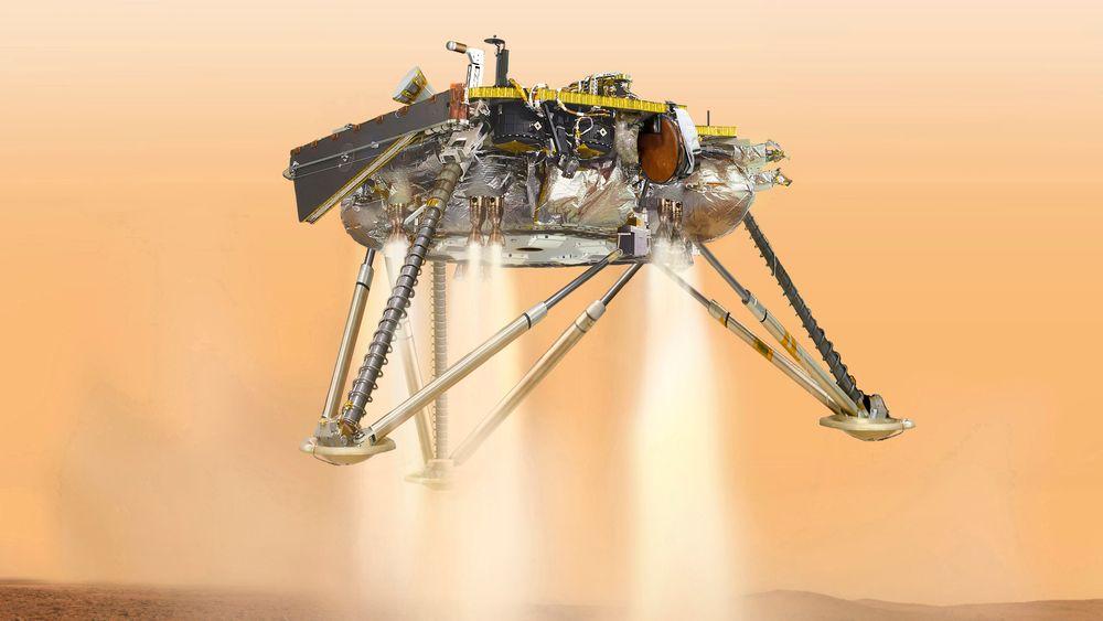 En illustrasjon fra 2016 viser Mars-sonden InSight i det den lander. Mandag er sonden framme etter en seks måneder lang ferd fra jorda.