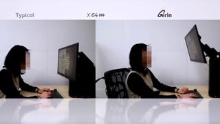 Denne skjermfoten justerer seg automatisk for å forbedre sittestillingen din