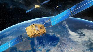 Satellitter med jorden i bakgrunnen.