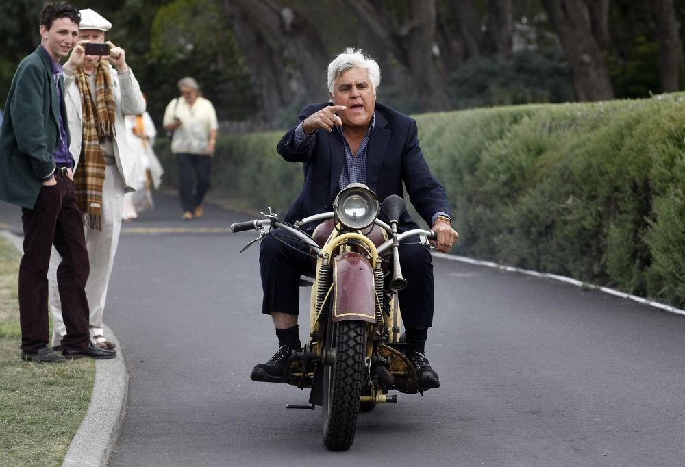 TV personality Jay Leno rides a 1930 Bohmerland motorcycle around the grounds during the Concours d'Elegance at the Pebble Beach Golf Links in Pebble Beach, California, August 17, 2014. The Concours tops a week-long celebration of automobiles and car culture on the Monterey Peninsula. REUTERS/Michael Fiala (UNITED STATES - Tags: SOCIETY TRANSPORT ENTERTAINMENT BUSINESS TPX IMAGES OF THE DAY)