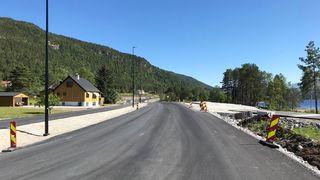 Lengre byggetid og mindre kontrakter kuttet kostnadene på veistrekningen med 50 millioner kroner