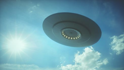 3D illustration with photography. Alien spaceship under the sun.